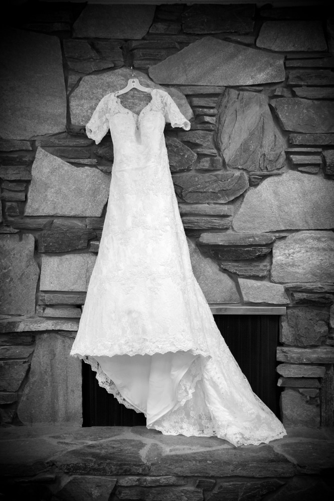 Black and White Photo of Modest lace, and long sleeved Wedding Dress