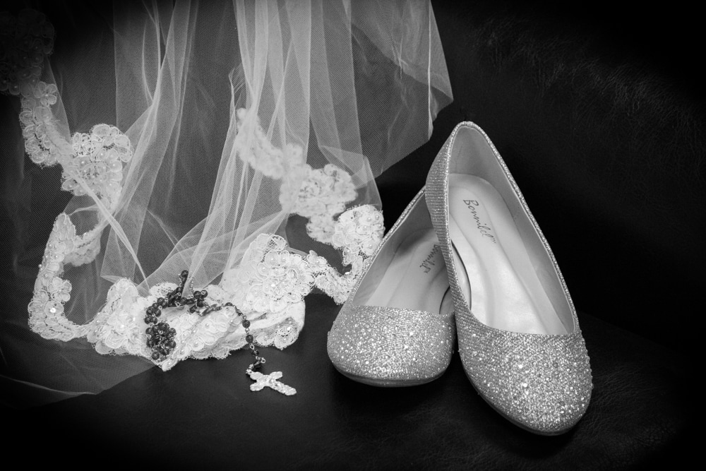Wedding Details Photo of sparkly flat shoes, veil with lace, and a Catholic rosary.