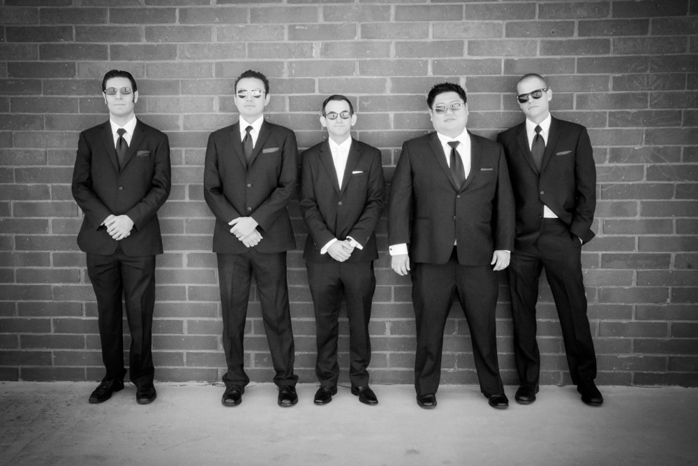 groom and grooms men in men in black pose