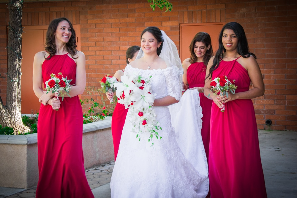 Bride and Bridesmaids in red dresses at St Andrew Neman's Center