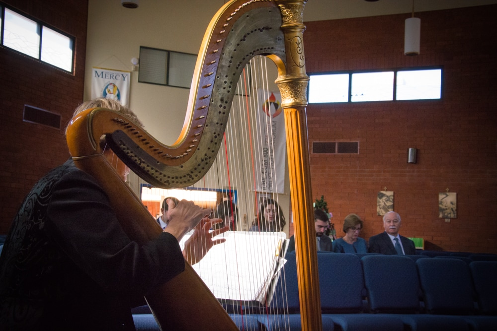 Harpist during wedding at St. Andrew Newman's Center