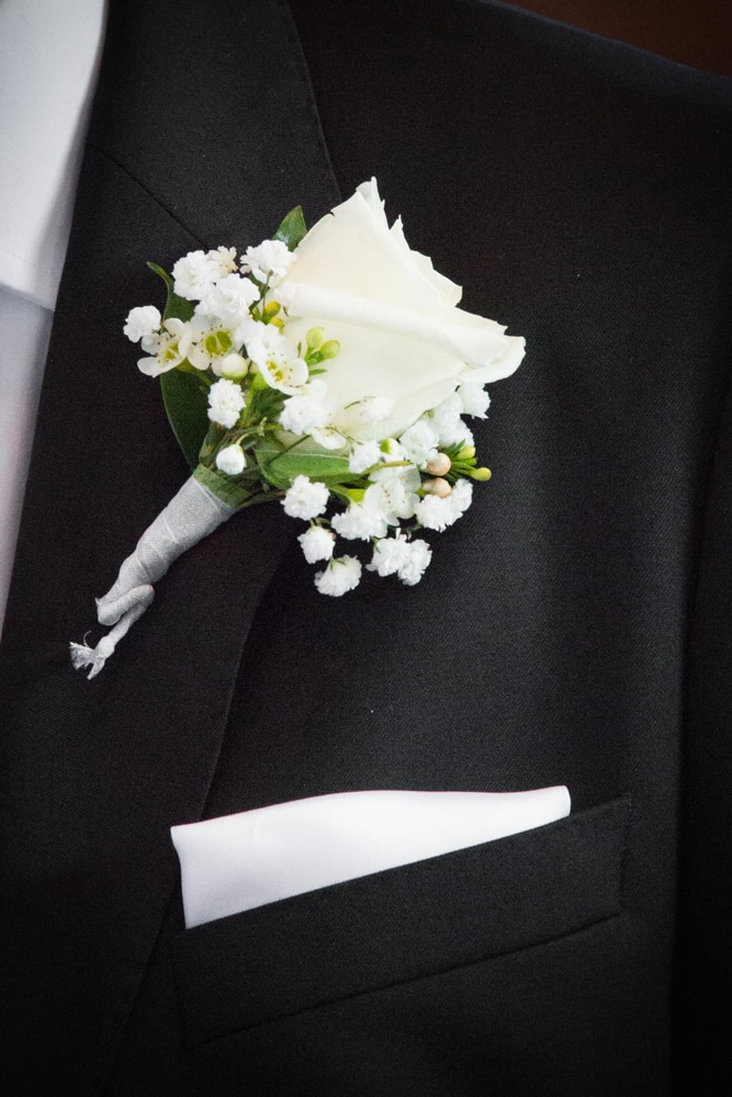 White Rose Wedding boutonnière from Riverside Mission Florist