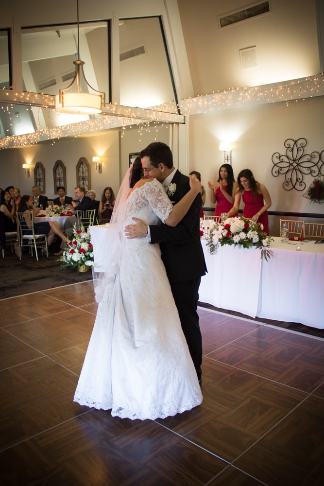 Bride and Groom hug after first dance at Riverside Canyon Crest Country Club