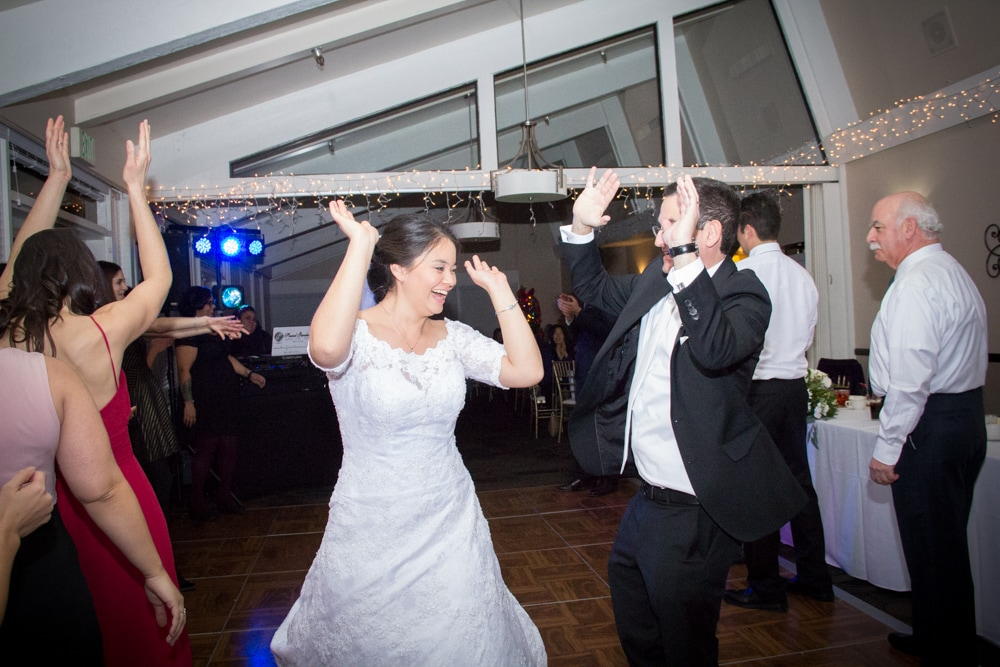 Bride and groom dance during reception party