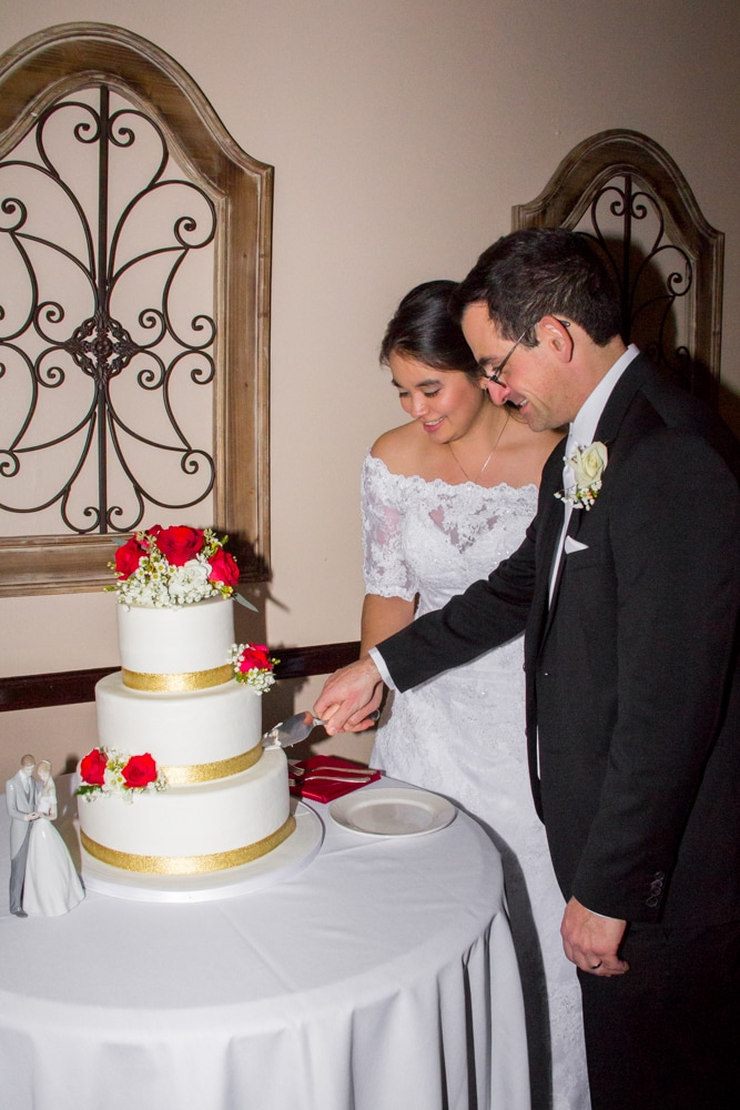 Bride and groom cut cake at Mother-Son dance at Canyon Crest Country Club