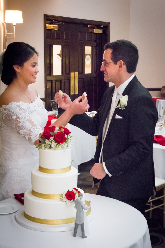 Bride and groom share cake at Mother-Son dance at Canyon Crest Country Club
