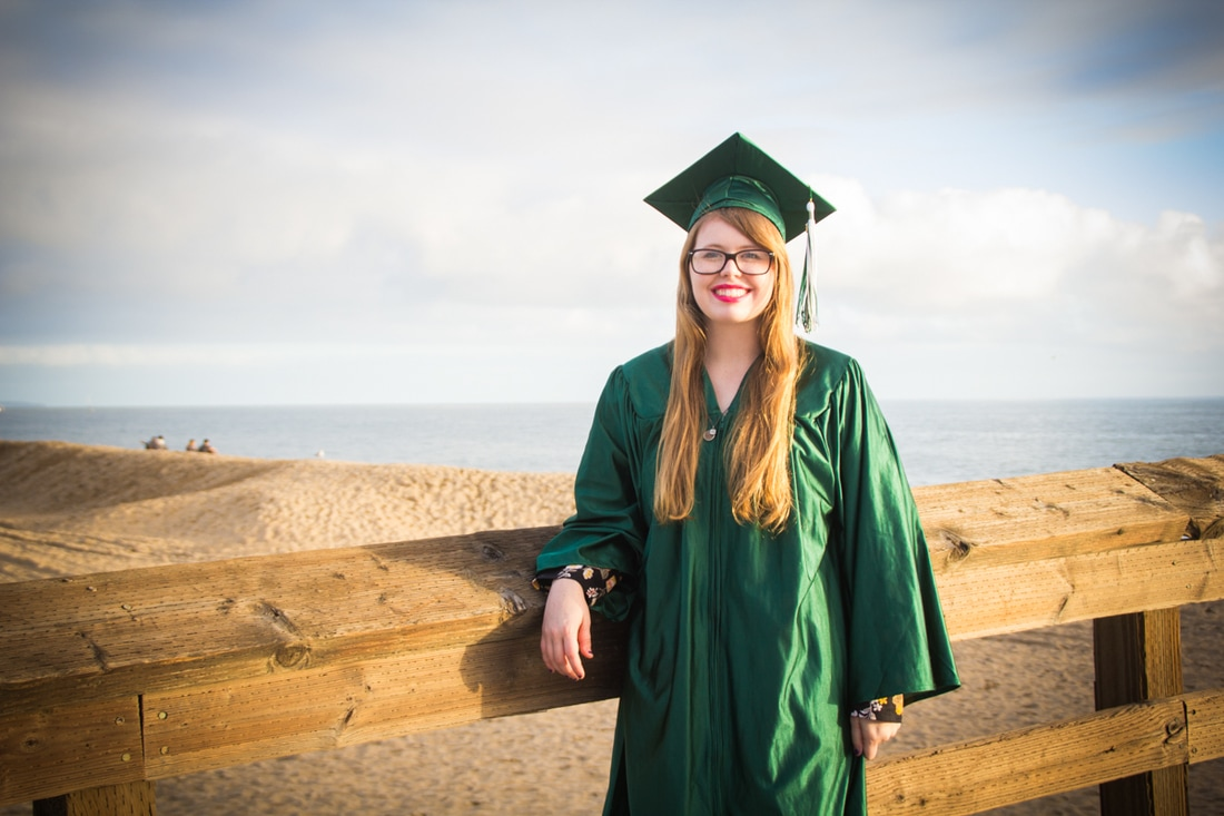 Senior Graduation Photo in front of Ocean on Balboa Pier