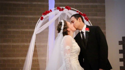 Bride and groom kiss at their church wedding in corona ca
