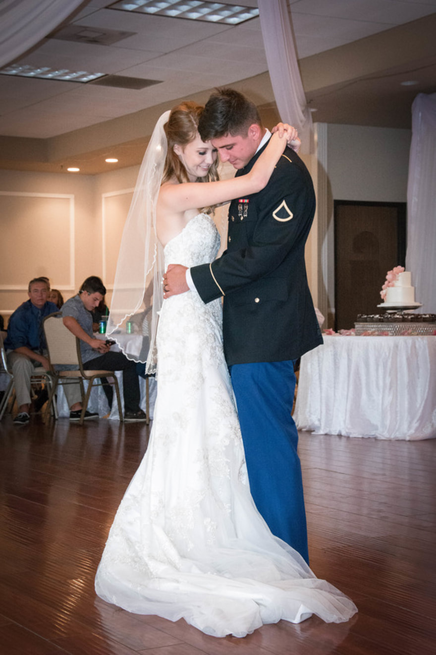 bride and groom's first dance at norco village banquet hall