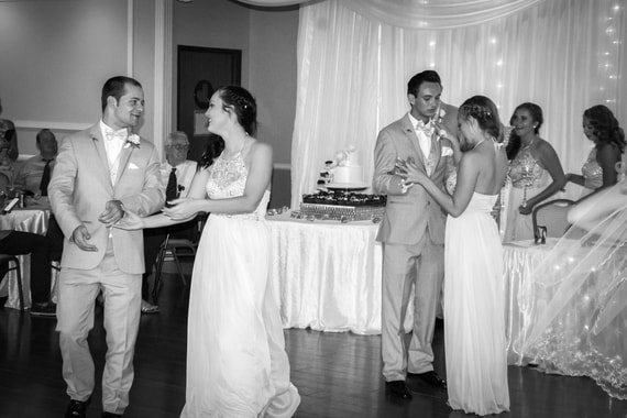 bridesmaids and groomsmen joining couple in first dance