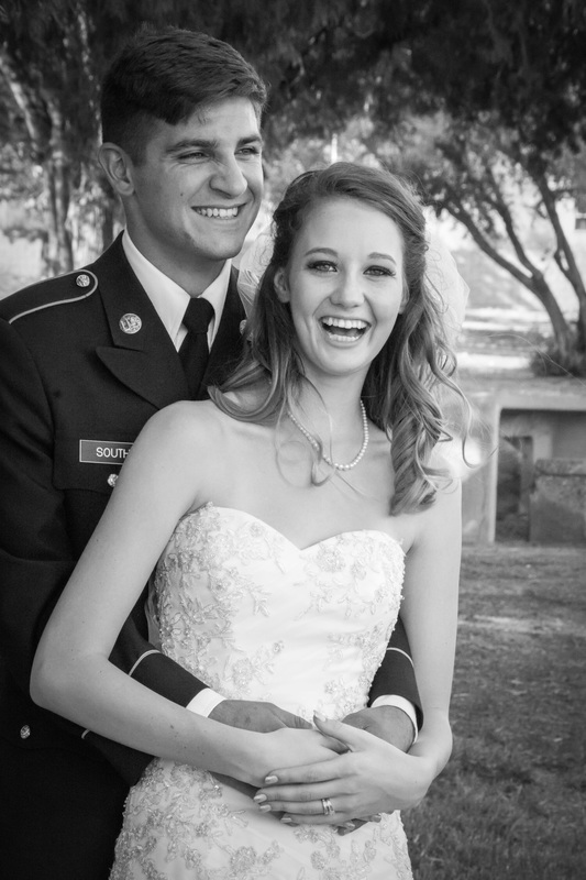 bride smiling at the camera and laughing with happiness